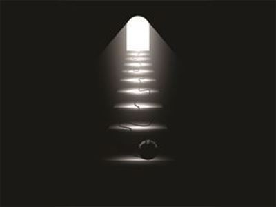 Dark stairway with light at the end and ball