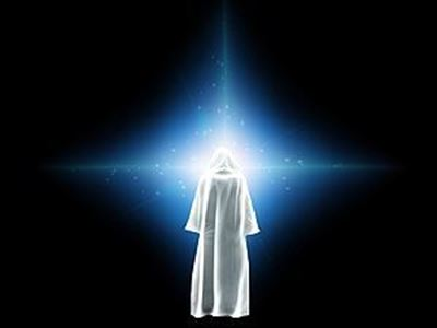 white cloaked figure looking at a light in the darkness