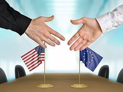 hands about to shake - different flags on each side