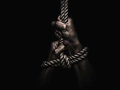 hands bound and hanging on a rope