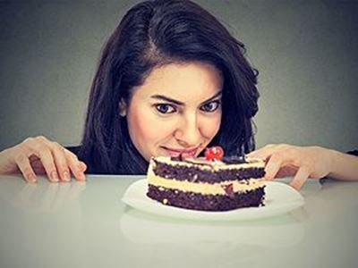 Lady staring at cake